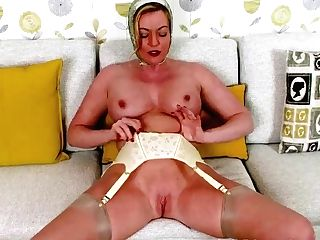 Blonde Mummy Holly Smooch Loves Flashing And Wanking In Her Sheer Nylons Stilettos And Retro Suspenders Under Her Rain Mac