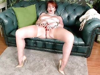 Red-haired Cougar Masturbates In Retro Chic Undergarments Seamed Nylon Designer Stilettos